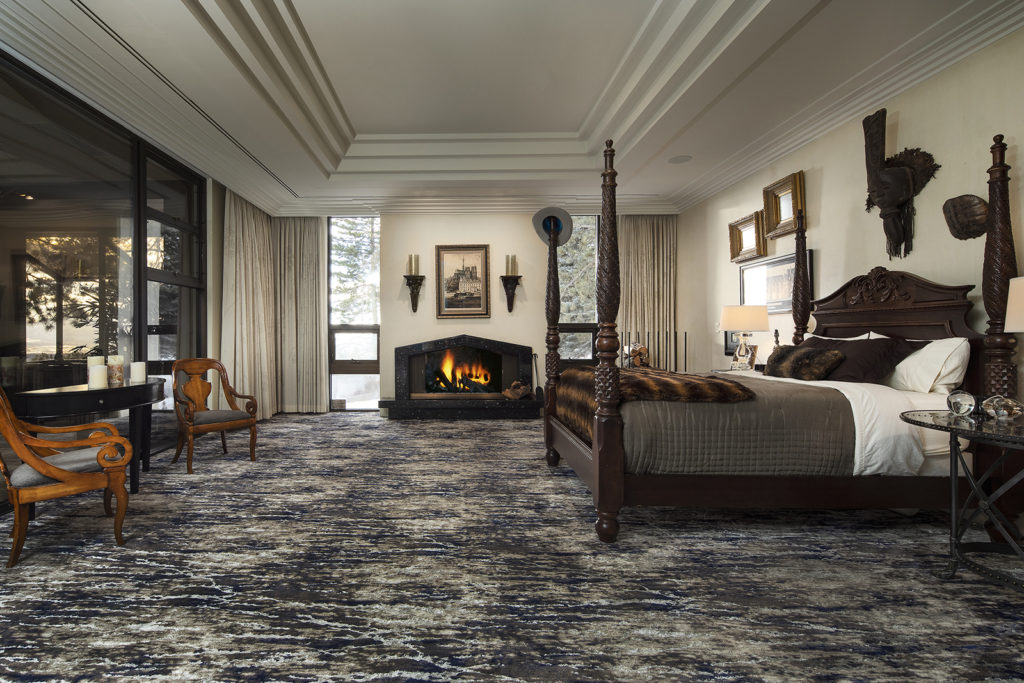 Master Suite with a fire place centered as a focal point.