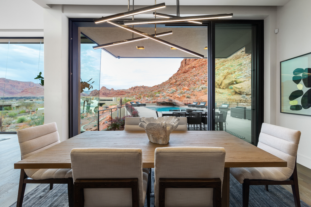 Dining room with floor-to-ceiling windows and glass doors