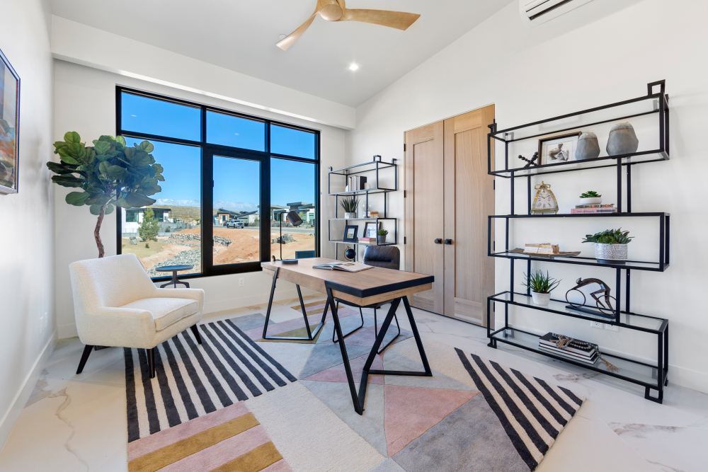 Office with black accents and open shelves at the 2021 St. George Area Parade of Homes