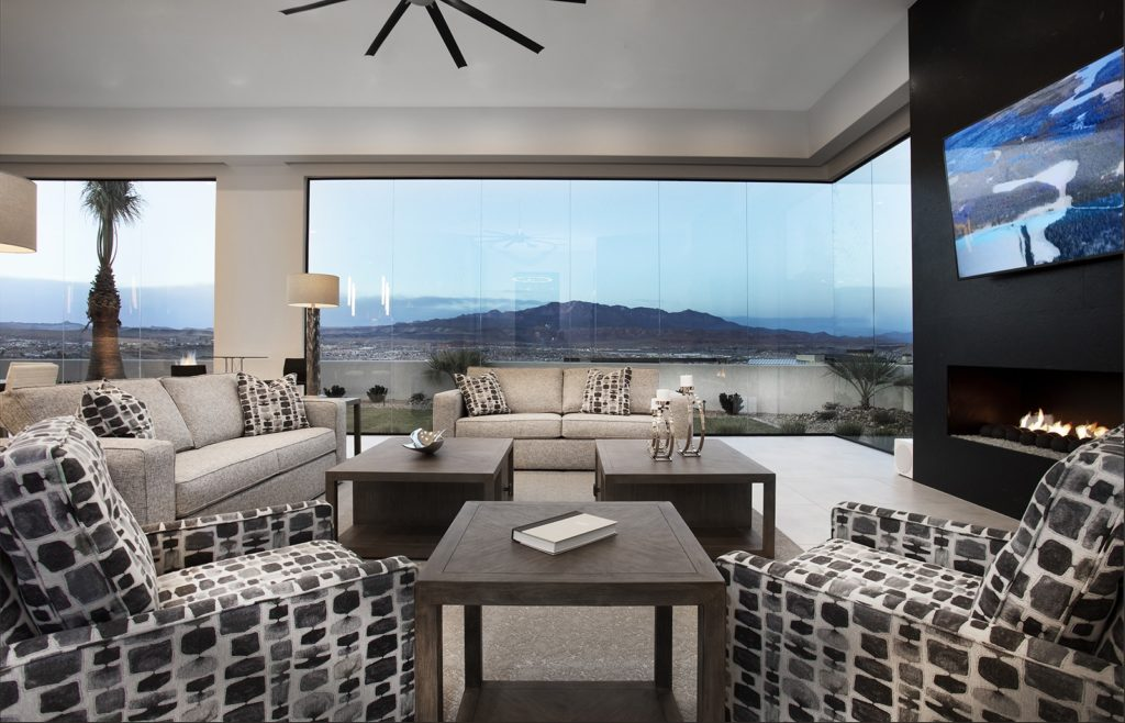 Great room with floor-to-ceiling windows by Anderson Custom Homes