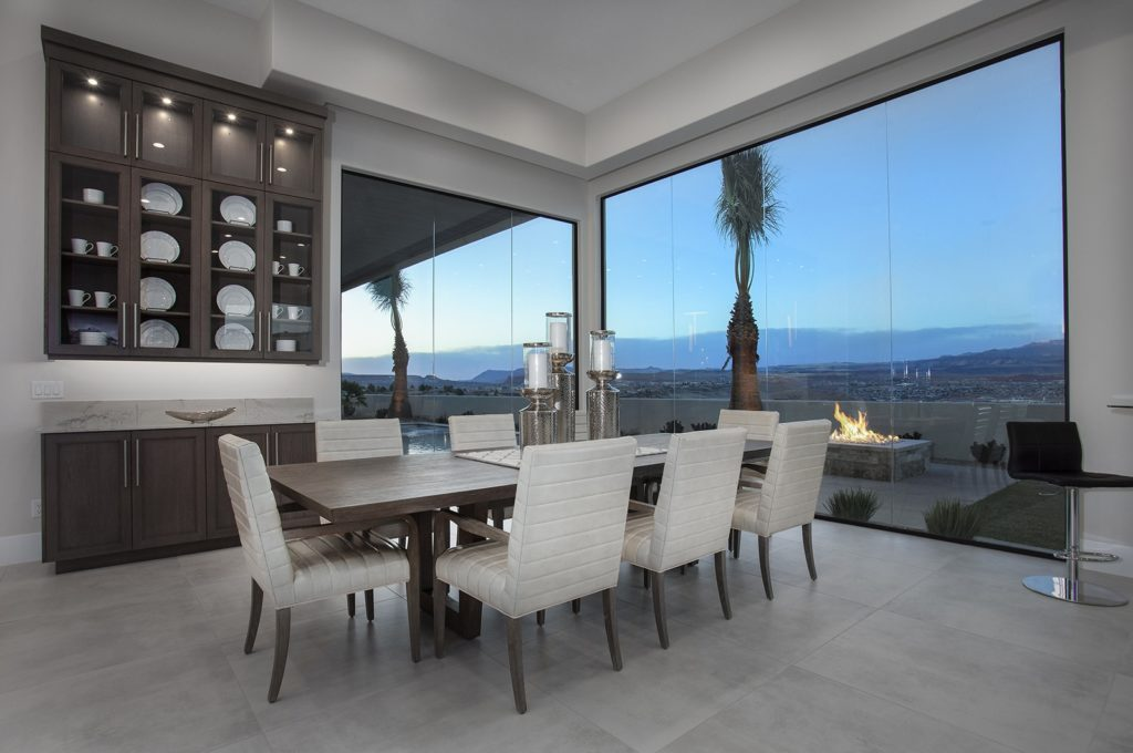Dining area with built-in hutch and stone-topped cabinet