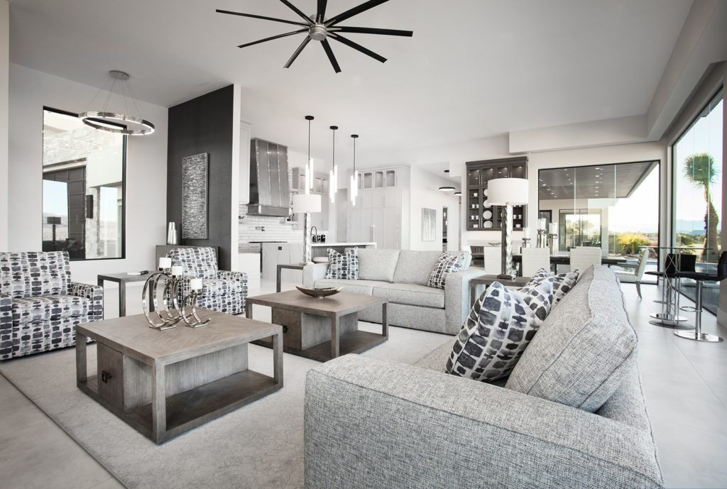 Open floor plan great room with neutral color palette by Anderson Custom Homes