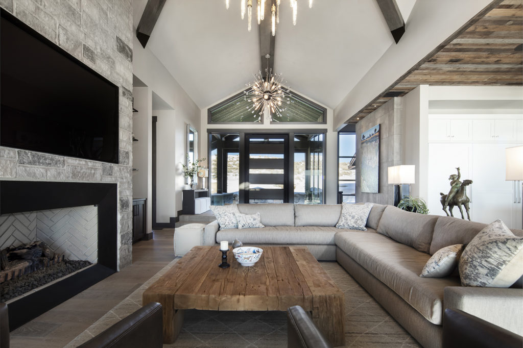 Otto-Walker Architects, Upland Development, wood and glass door, pivot door, glass entryway, open-planned living area, wood coffee table, stone fireplace, neutral tone couch