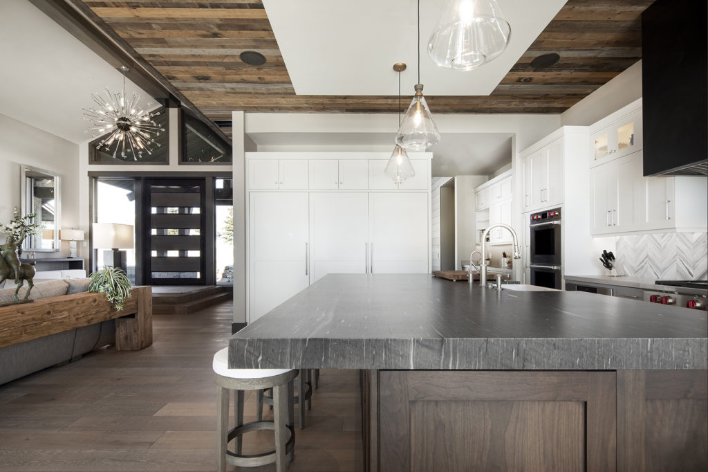 Otto-Walker Architects, Upland Development, reclaimed lumber ceiling, white cabinetry, glass light fixtures, walk-through butler's pantry, kitchen island, open living