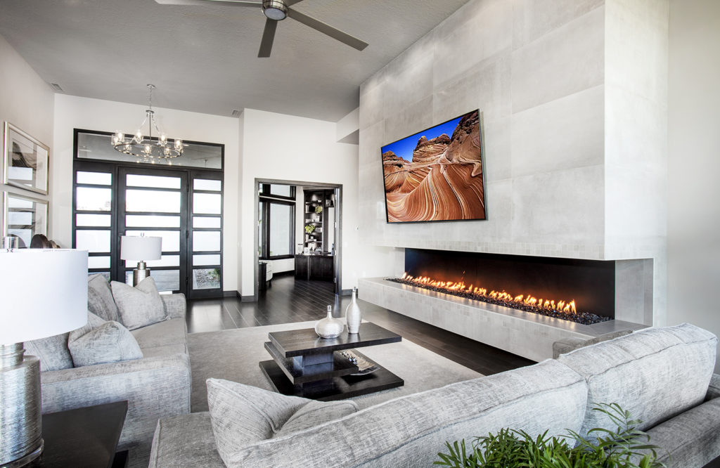 KH Traveller Custom Homes focused the living space around a wall-length gas fireplace.