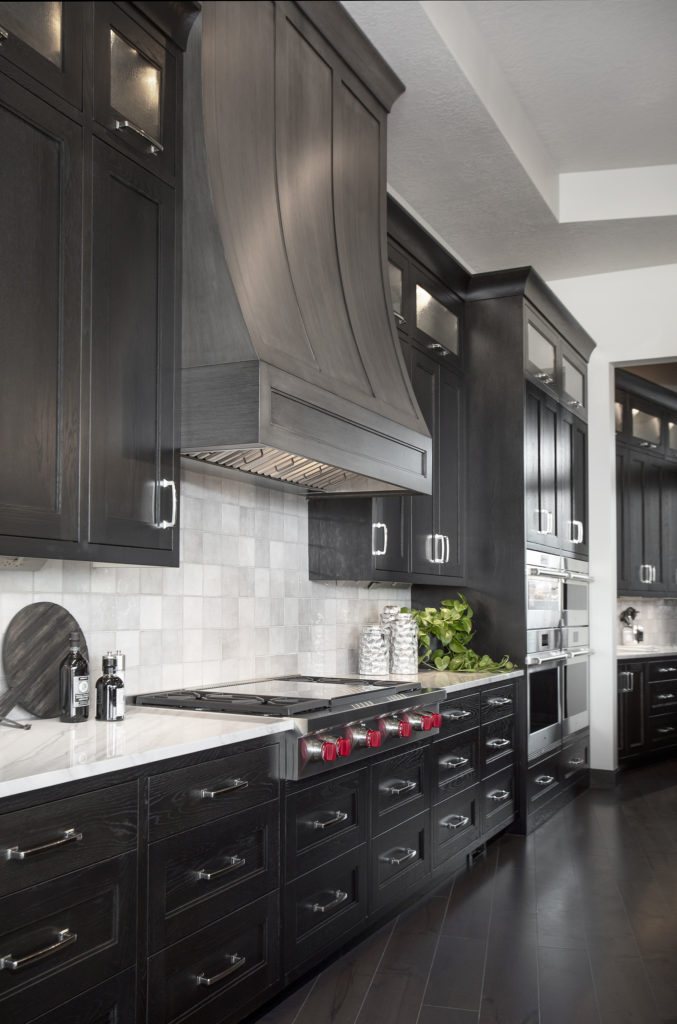 Stunning kitchen detail features furniture-like cabinetry.
