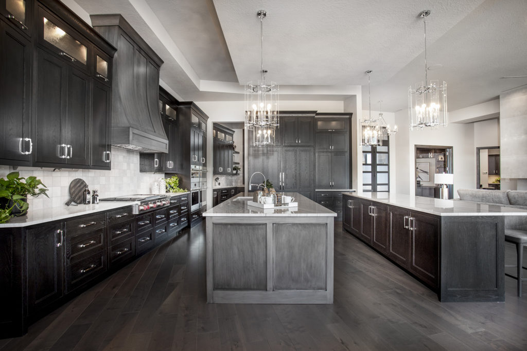 The central kitchen island compliments this extensive kitchen designed by KH Traveller Custom Homes.