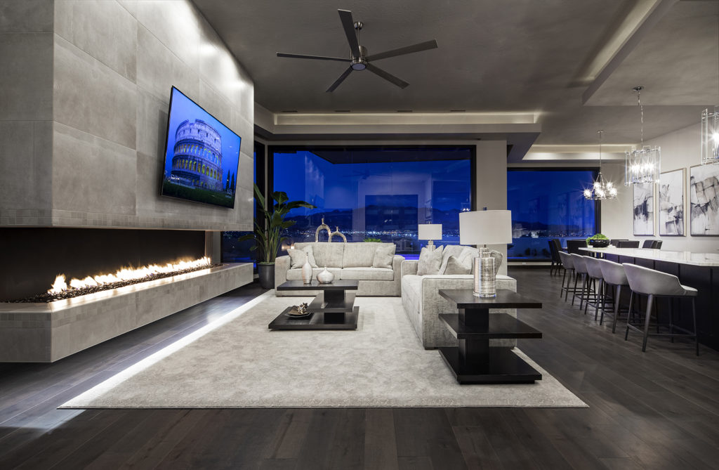 The modern living room features an open floor plan and interior design by Tasteful Interiors.