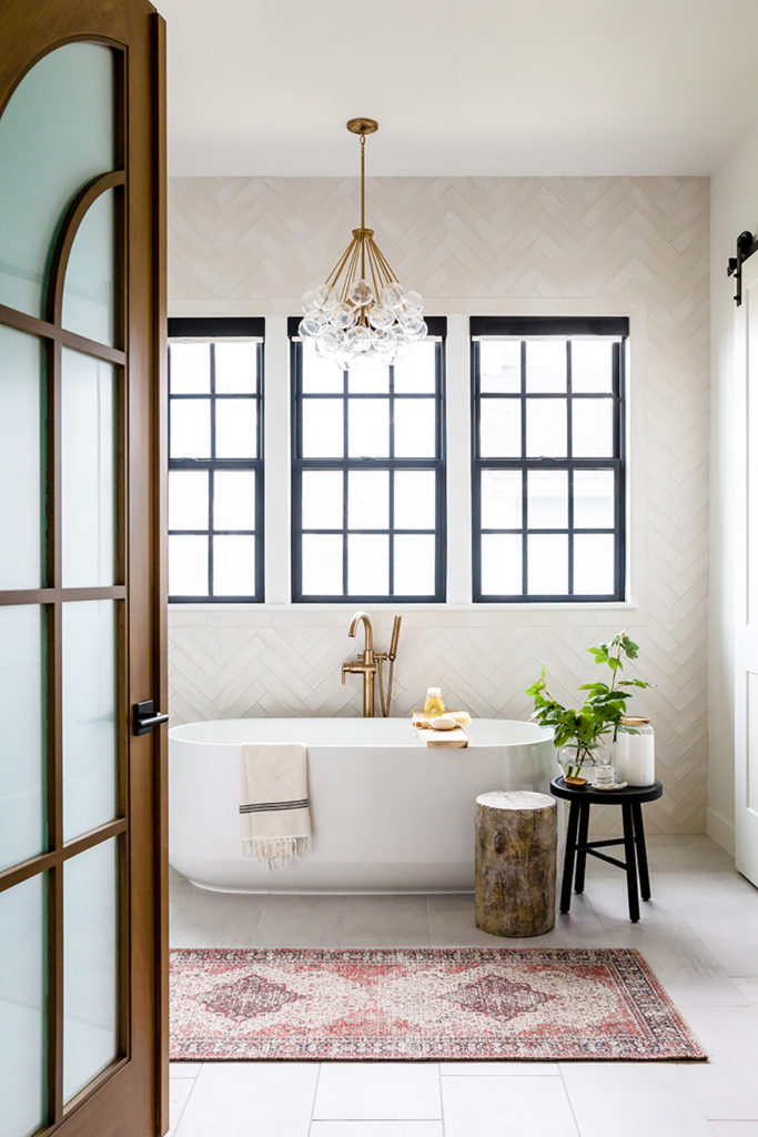 Devine house, Lindsay Salazar, House of Jade Interiors, arched doors, freestanding tub, glass bubble chandelier, geometric tile wall