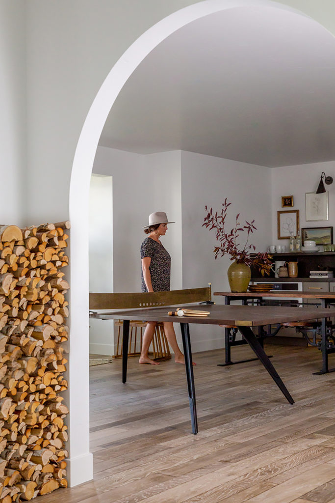 Devine house, Lindsay Salazar, House of Jade Interiors, lower level, modern ping pong table, floor to ceiling firewood