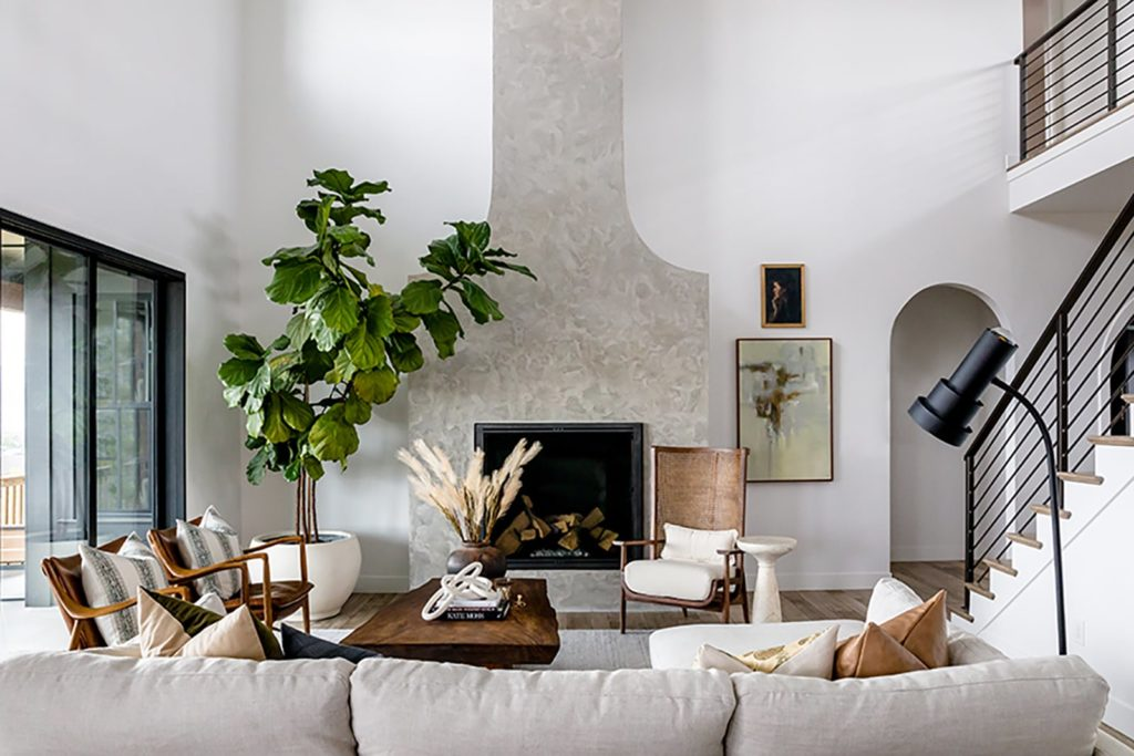 Devine House, Lindsay Salazar, House of Jade Interiors, living room, modern plastered fireplace, live-edge cocktail table, woven cane-back chair, textured fabrics, fiddle leaf fig