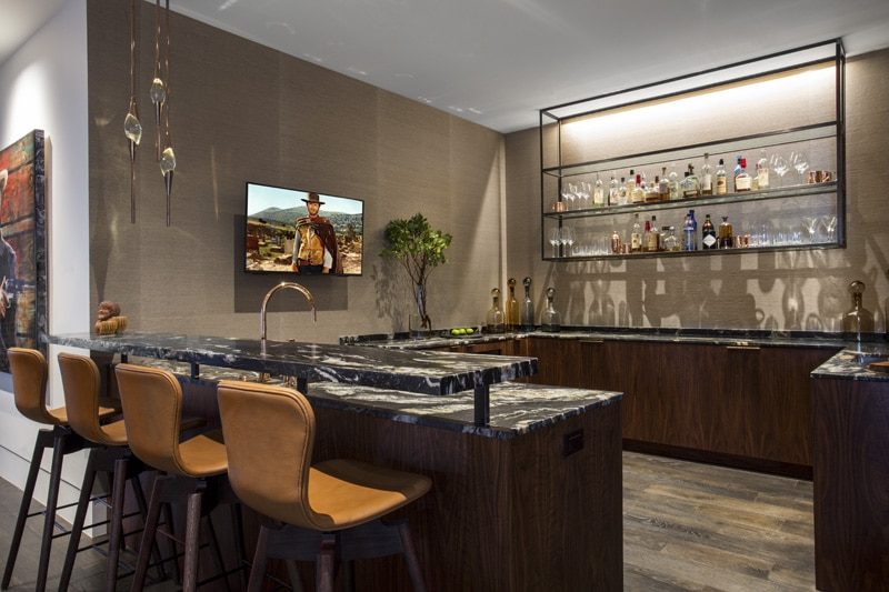 Bar area with whiskey-colored grasscloth wallpaper