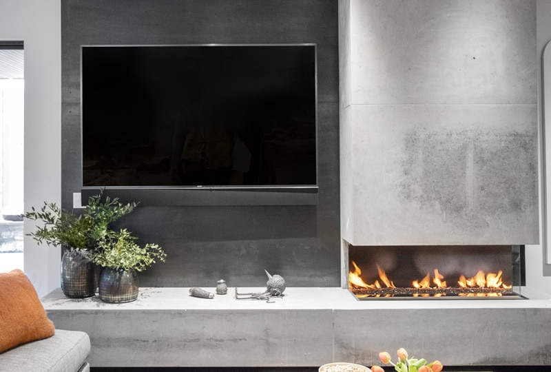 Limestone-clad, three-sided fireplace