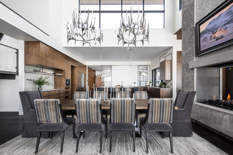 Mohair chairs, sapwood-edged table and modern antler-shaped chandeliers